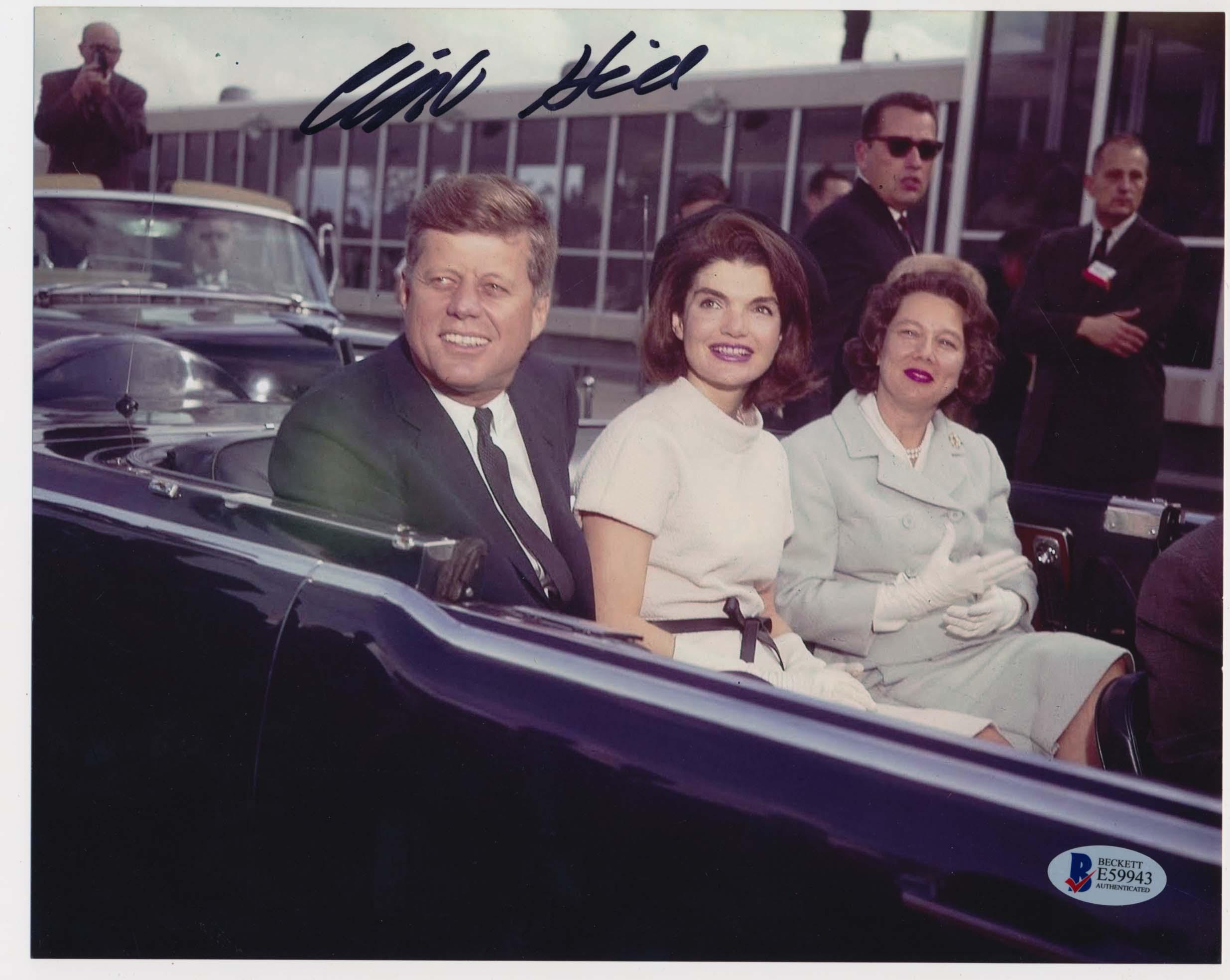 Lot #710     Hill, Clint Signed JFK and Jackie Kennedy Dallas Motorcade Photo  (JSA LOAA) Cond: 9.5