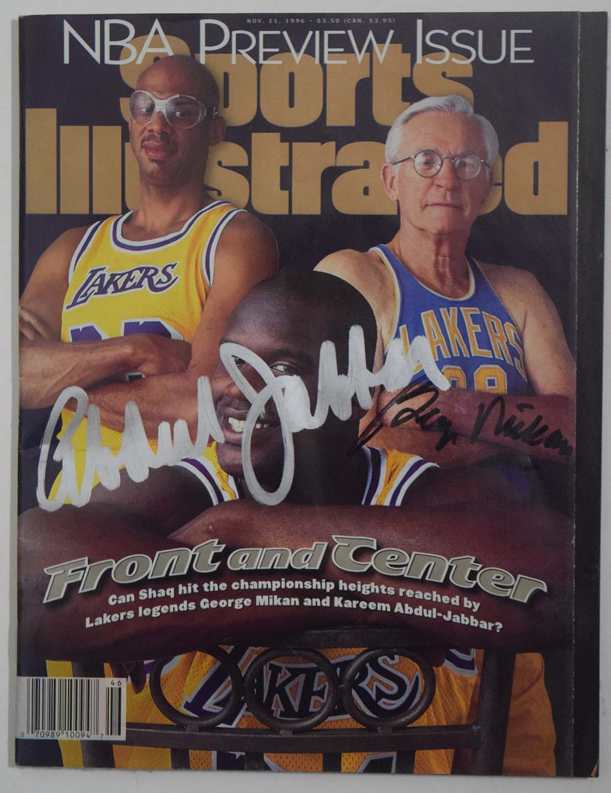 Lot #912     Jabbar/Mikan Signed Sports Illustrated (11/11/96) Cond: 9